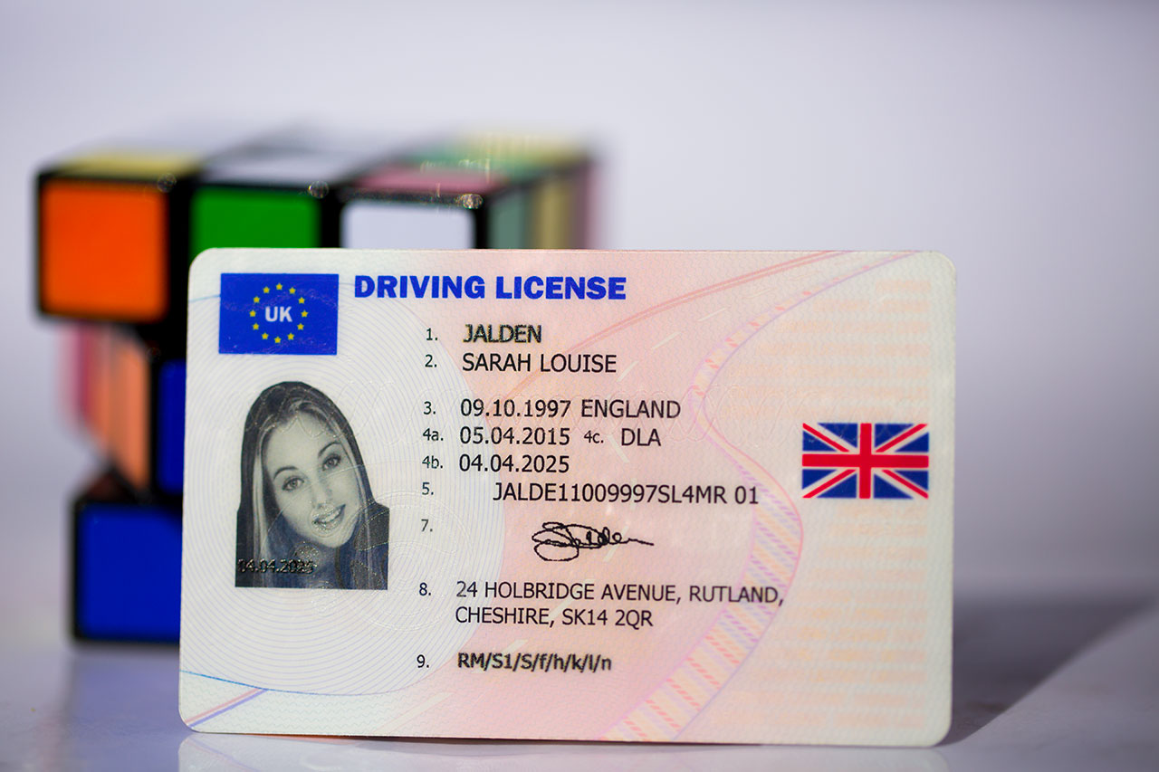 UK Driving License front with Rubix Cube