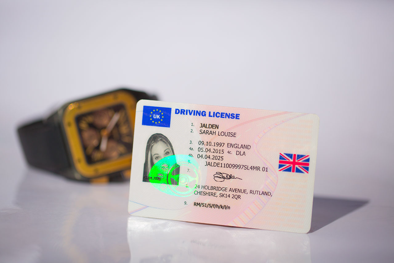 UK Driving License front with watch